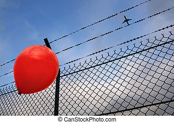 Barbed freedom (Liberté barbelée) - A red balloon in danger