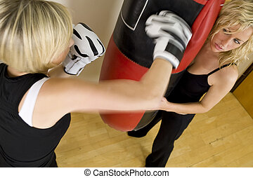 Boxing Work Out - Motion blurred shot of two beautiful young...