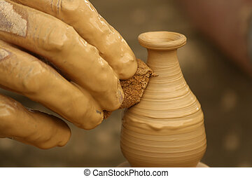 Potters fingers - Close-up of fingers making pottery on a...