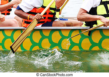 Racers - Competitors rowing towards the finish line in a...