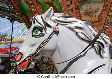 Carousel horse - Brightly painted carousel horse bathed in...