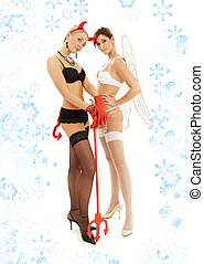 extremes with snowflakes - picture of angel and devil girls...