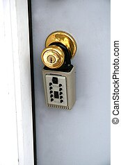 foreclosure - lockbox on home entrance