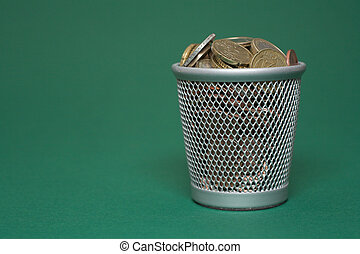 Wasted money - coins - Photo of a waste basket full of...