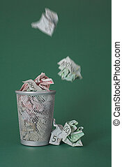 Wasted money - Euro bills - Photo of a waste basket full of...