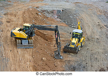excavator - works in an industrial zone in construction...