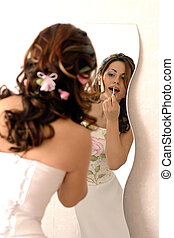 Bride putting on make up - A bride putting on her make up in...