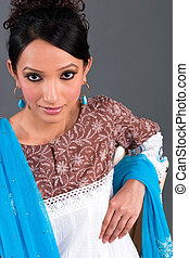 Indian Embroidered Womens Apparel - A model wearing a...