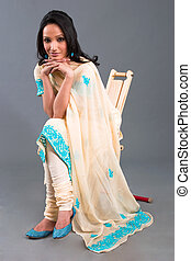 Indian Embroidered Women's Apparel - A model wearing a...