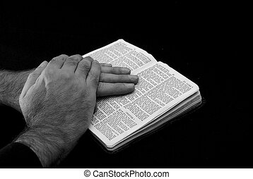 faith - touching black and white image of a hand of man...