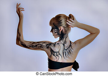 Beautiful girl with a paint on her skin