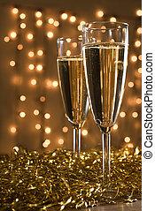 Two champagne flutes. - Two champagne flutes among golden...