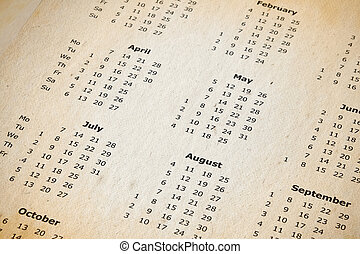 stained yearly calendar page - part of an old stained yearly...