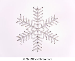 Snow flake - A snow flake ornament against a white...
