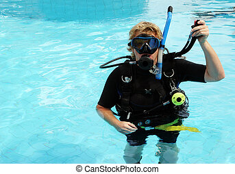 Scuba diver in the swimming pool.