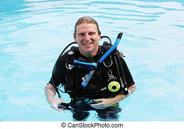 Scuba diver - Happy scuba diver in the swimming pool.