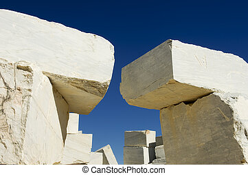 Marble blocks stacked near a marble quarry, Alentejo,...
