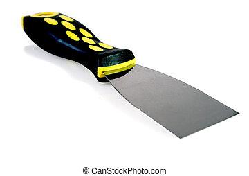 Putty knife on bright bakcground