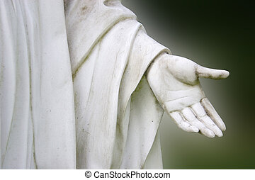 Stone hand - A hand of a stone monument on dark background