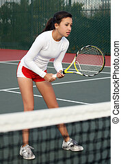 Girl playing tennis - A teenage girl playing tennis