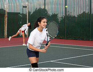 Girls playing tennis - Two girls playing tennis
