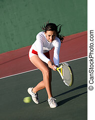 Girl playing tennis - Teenage girl playing tennis