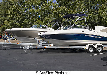 Two Boats on Trailers - Two luxury ski or fishing boats on...