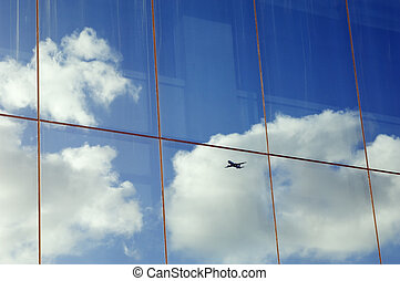 Airplane reflection - Airplane, sky and clouds reflected in...