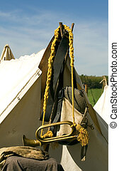 Bugle - Civil war era bugle hanging on gold cord over tent