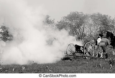 Canon Fire - Confederate soldiers firing a canon at a civil...