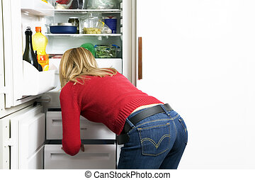 home life: girl looking for something to eat