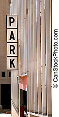 Parking Ramp - An old fashioned park sign hanging on a...
