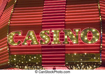 Casino Neon - A casino sign in red neon and light bulbs