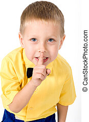 quietly - portrait of little boy on the yellow shirt