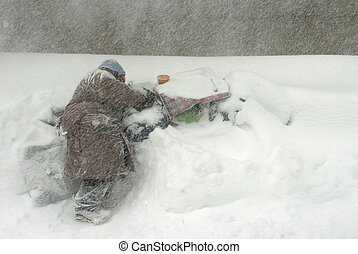 Homeless in Blizzard - Homeless man dealing with snow, wind...