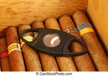 Cigarros, cortador