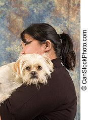 Asian woman with pet dog - Asian woman holding pet dog in...