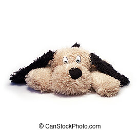 Soft toy dog - Beige soft toy dog with long black ears lying...