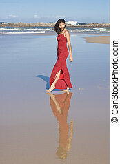Lady in Red - Lady in red dress walking at the beach