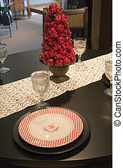 Christmas Place Setting - A formal place setting on a table...