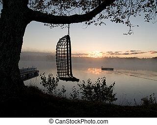 Hammock - Hammond overlooking a misty lake at sunrise in...