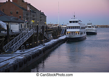 Boston harbor - Two boats docked in Boston harbor on a cold...