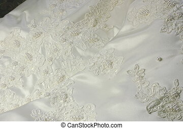 bridal gown - details of a bridal gown showing the intricate...