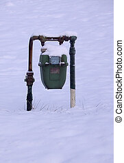 Gas Meter - Gas meter with snow on it in snow-covered yard.