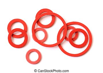 Red Gakets - Macro of red gaskets isolated on white