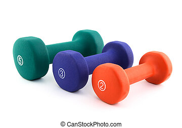 Three colorful dumbbells of different size of white...