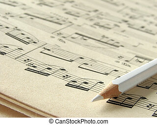 musical notes - old sheet of musical symbols with pencil