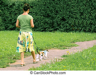Walk with a cat - Woman with a lady-cat on a walk Warm sun...