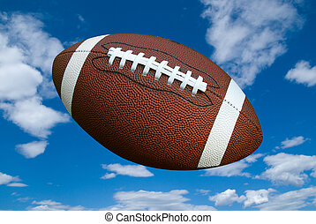 Football - American football isolated over a cloudy sky...