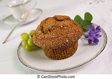 Bran muffin - Gourmet Bran muffin on a silver rimmed plate...